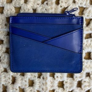 Slim blue faux leather wallet angled card slots